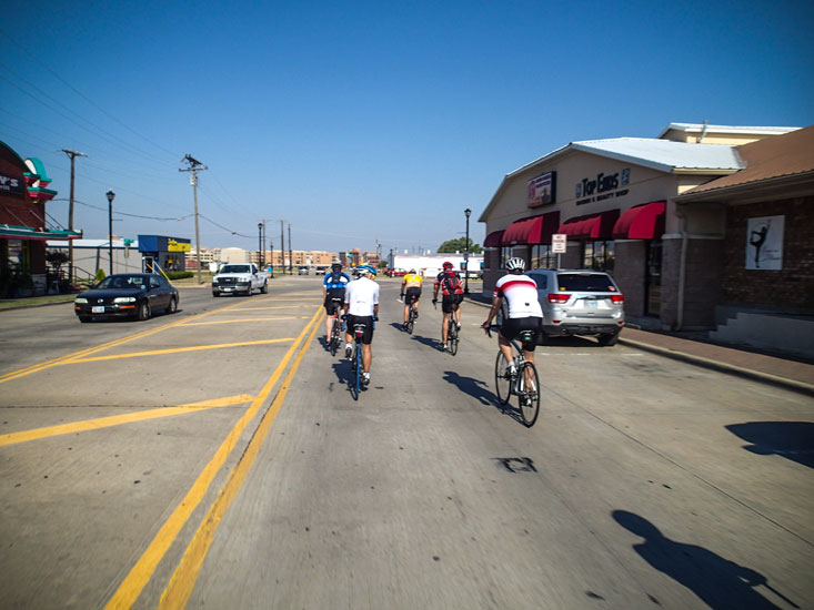 Our little peloton rolls down Main street in Frisco, soon to pass the MLS soccer stadium.