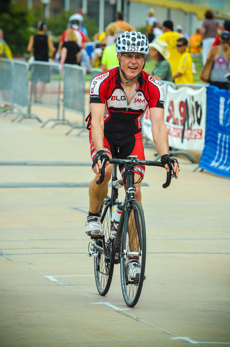 Wearing an uncontrollable grin approaching the finish.