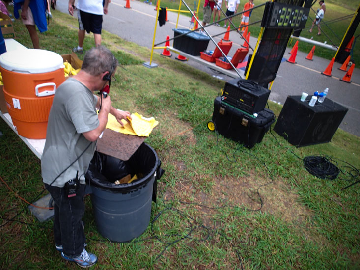 The announcer worked old-school, cross-referencing bib numbers to call out runners' names.